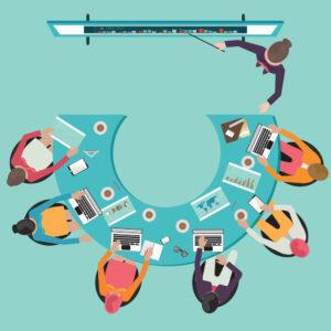 uma mesa de reunião vista de cima com 6 pessoas e um palestrante discutindo as principais mudanças na nr 20.
